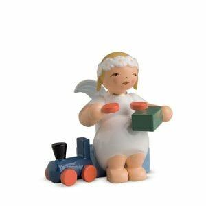 Marguerite Angel Sitting with Train by Wendt & Kühn Image